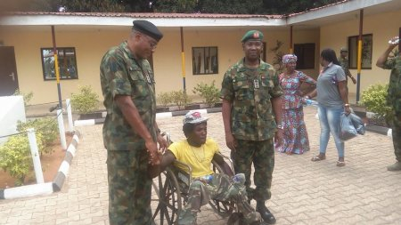 Photo of PHOTOS: Nigerian Army Meets Crippled Man Molested By Soldiers For Wearing Camouflage In Onitsha