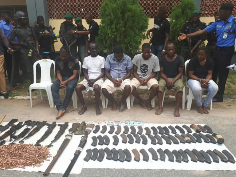 Members of Evans' kidnapping gang and the weapons seized from them