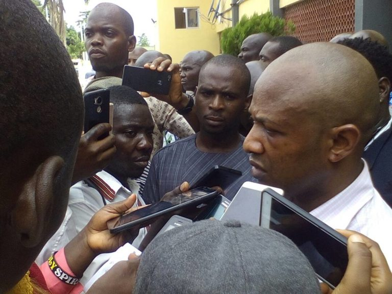 Evans speaking to journalists during the parade