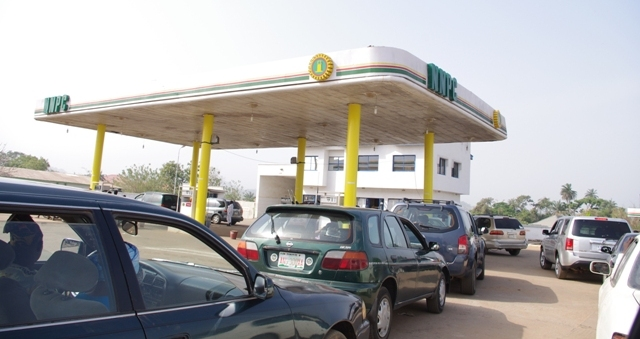 Queues building up at NNPC Poly Road while selling fuel at N87 per litre before ajusting its metres on MondayAdo Ekiti on Sunday - NNPC Releases 250 Trucks of Petrol to Address Fuel Scarcity In Lagos
