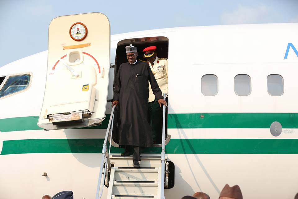 Photo of PHOTOS: President Buhari Welcomed at Abuja Airport After London Medical Trip