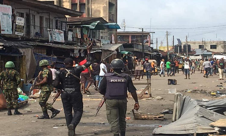 imo clash6 - PHOTOS: Youths, Police Clash In Owerri Over Relocation of Market