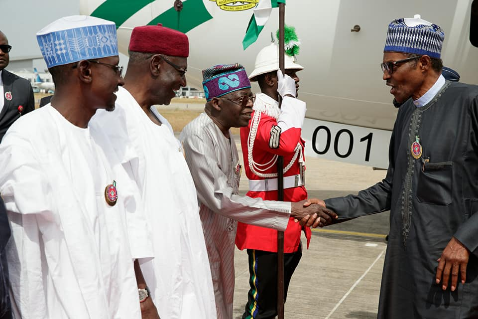PHOTOS: President Buhari Returns to Abuja After Participation at 5th AU-EU Summit In Abidjan