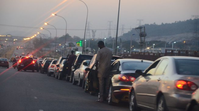 Fuel queue in Abuja dec 2017 653x365 - How to Report Filling Station Hoarding and Selling Fuel Above N145 per Litre