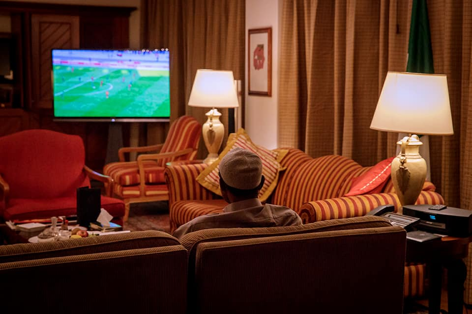 Buhari Watching Super Eagles - Buhari Hails Super Eagles For Defeating Sudan and Qualifying for 2018 CHAN Final