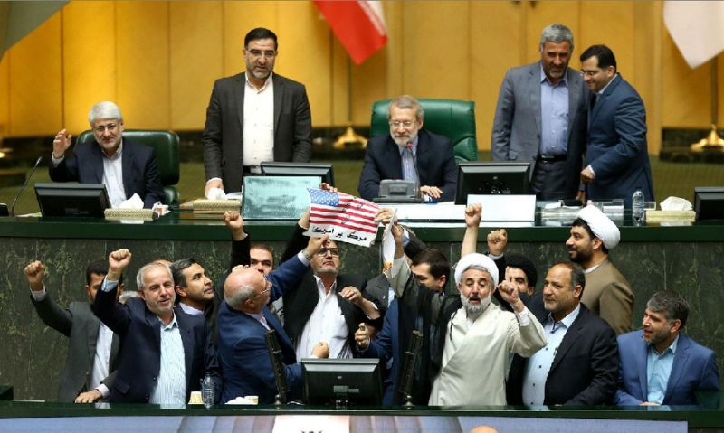 Photo of Iranian Lawmakers Burn U.S. Flag During Parliament