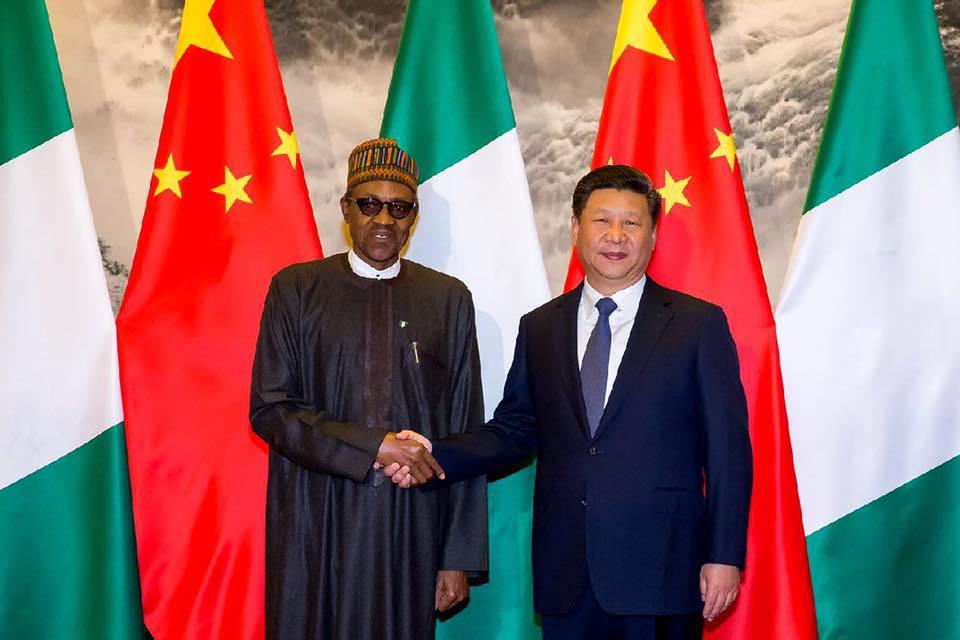 Muhammadu Buhari and Chinese President, Xi Jinping play President
