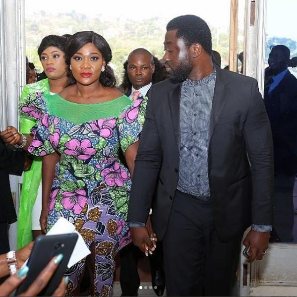 Photo of PHOTOS: Mercy Johnson And Her Husband Arrive Sierra Leone For Inauguration Of New President