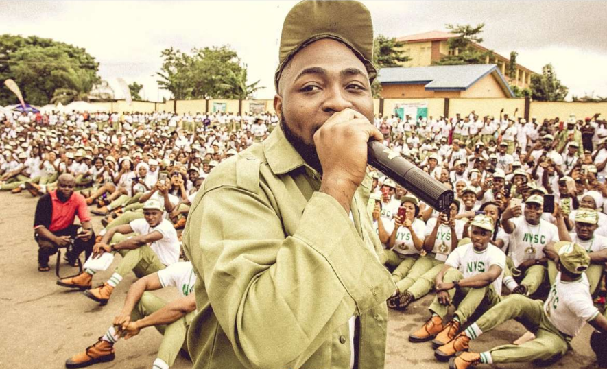 Video: Scores of corps members seat on the floor while Davido addresses them - OkayNG News