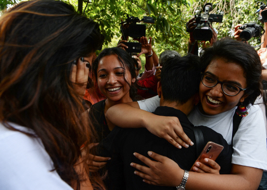 Members of the lesbian, gay, bisexual, transgender (LGBT) community celebrate outside the Supreme Court In India