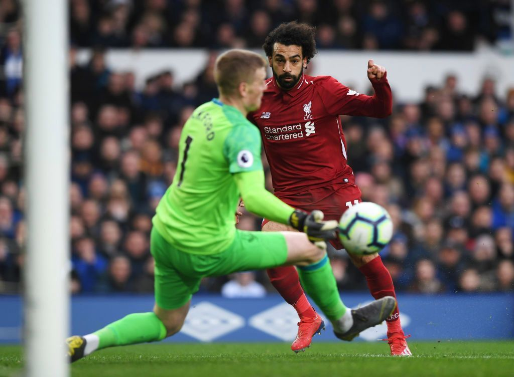Mohamed Salah and Jordan Pickford