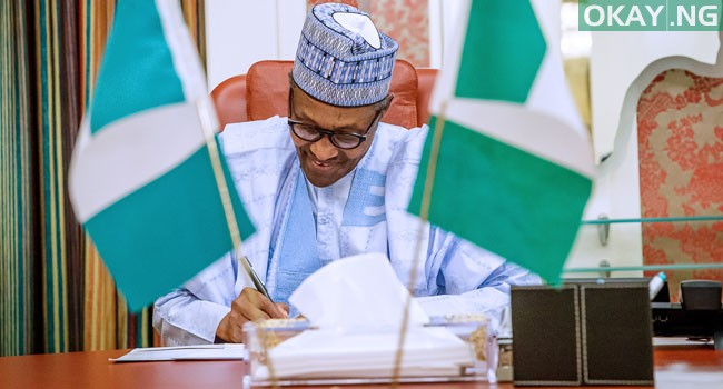 Photo of Buhari signs revised 2020 budget into law