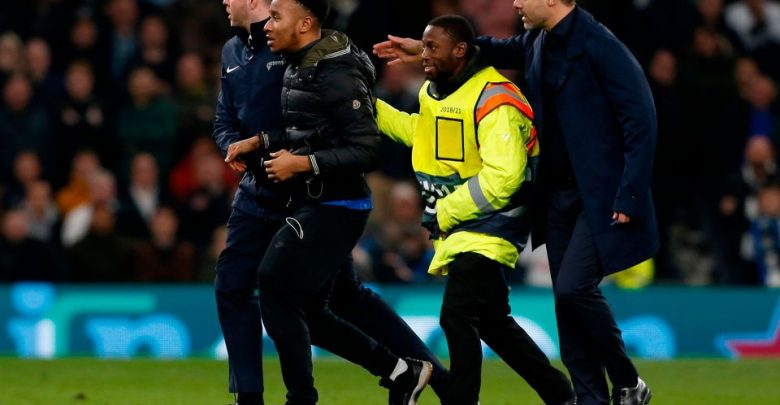 Photo of Tottenham charged by UEFA for fan pitch invasion during Champions League match
