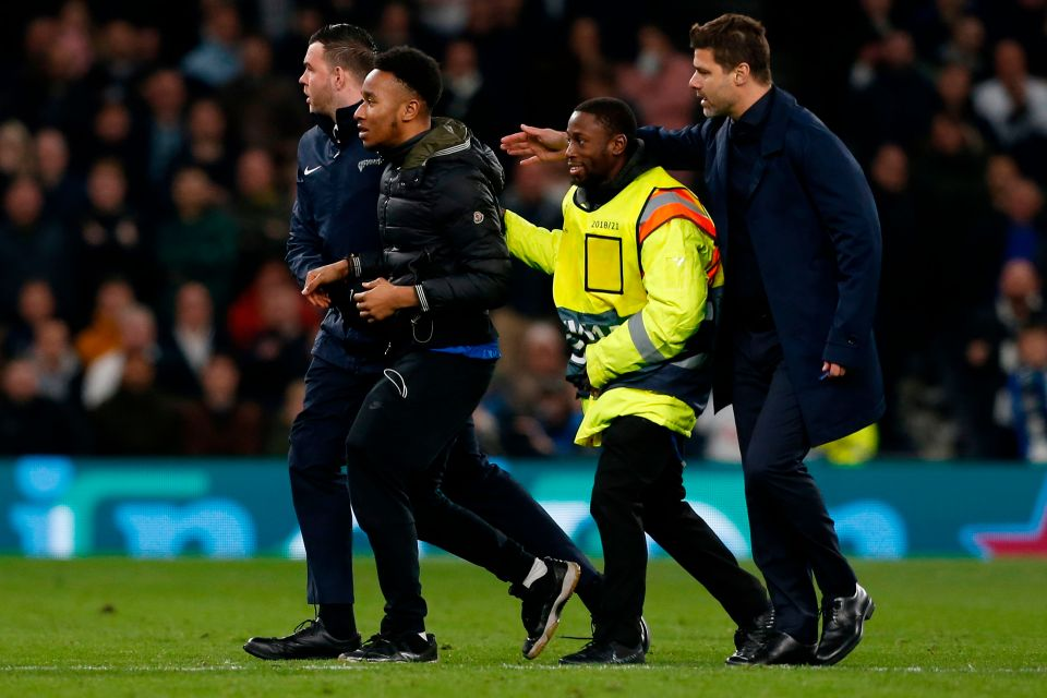 Tottenham fan Okay ng - Tottenham charged by UEFA for fan pitch invasion during Champions League match