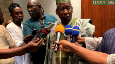 Ganduje speaking with newsmen