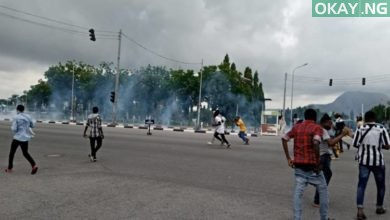 clash police Okay ng 390x220 - Vehicles burnt as Shiites, Police clash again in Abuja [Photos]