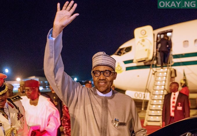 President Muhammadu Buhari waving his hand on arrival in Abuja from Japan