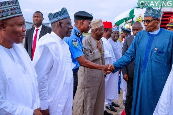 Photo of Buhari returns to Abuja from South Africa (Photos)