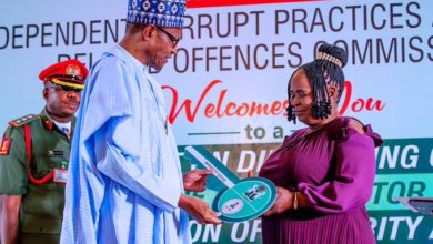 Photo of Buhari presents ICPC Integrity award to former airport cleaner