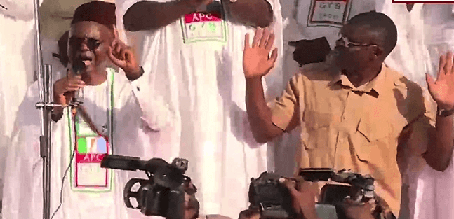 El-Rufai on his knees at a campaign rally in Kogi