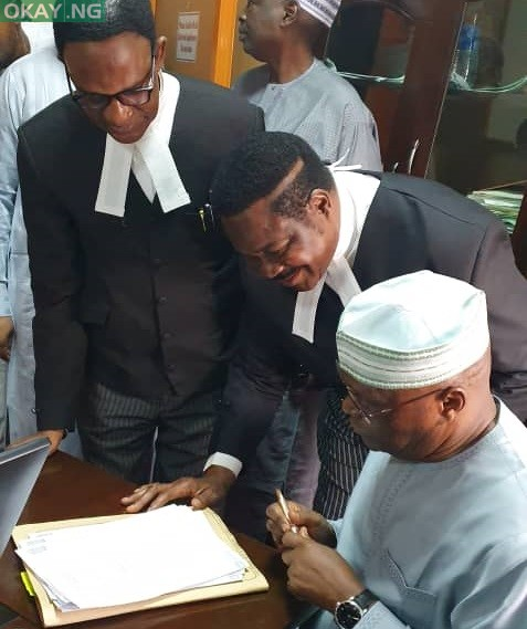 Atiku Abubakar sign his deposition in support of a N2.5 billion libel suit against an aide to President Muhammadu Buhari, Lauretta Onochie
