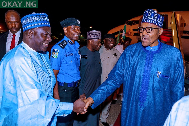 Buhari returns to Abuja after London trip [Photos from Bayo Omoboriowo]