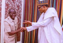 Photo of Buhari greets Oshiomhole at 68