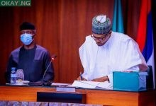 Photo of Photos of Buhari signing revised 2020 budget