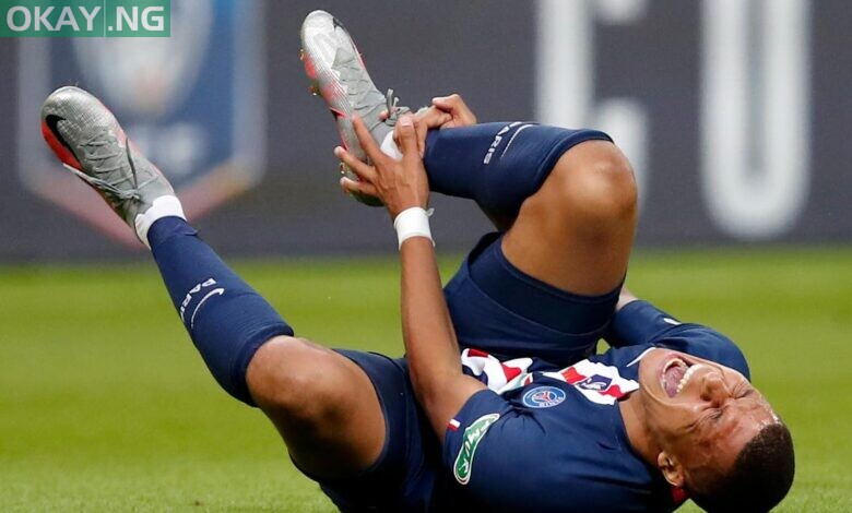 Photo of Mbappe injured, to miss PSG's Champions League quarter-final
