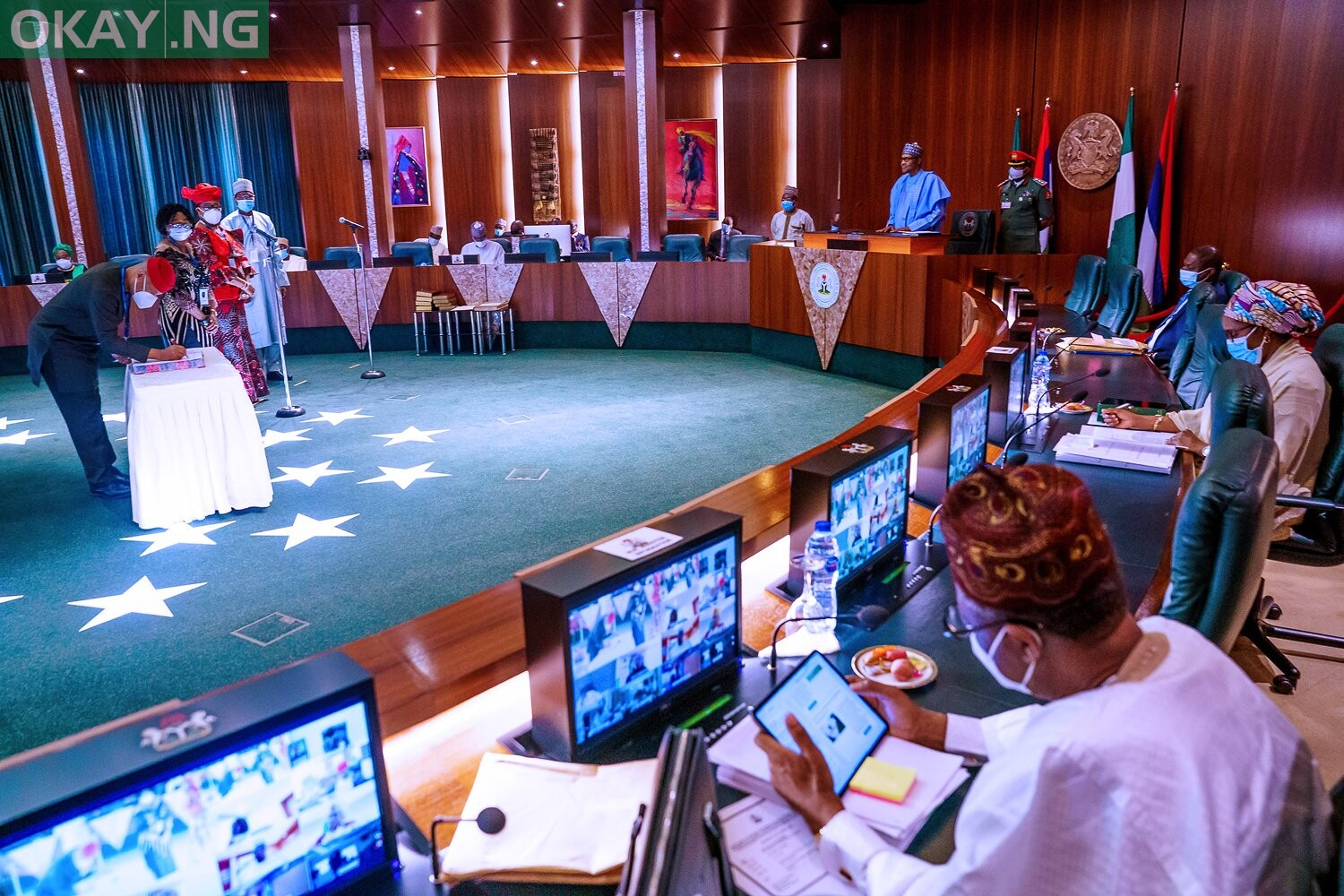 Photo of Buhari swears-in 12 newly appointed permanent secretaries