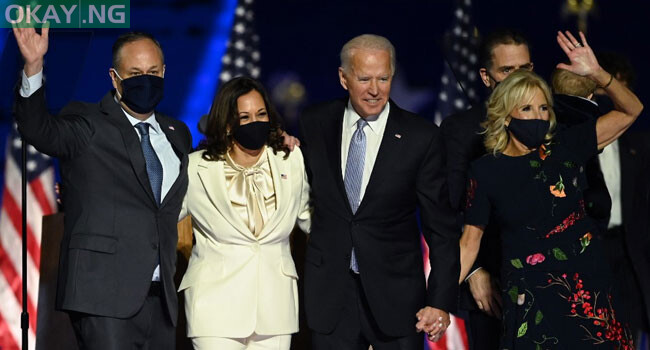 US President-elect Joe Biden and Vice President-elect Kamala Harris stand with spouses Jill Biden and Doug Emhoff after delivering remarks in Wilmington, Delaware, on November 7, 2020, after being declared the winners of the presidential election. Jim WATSON / AFP