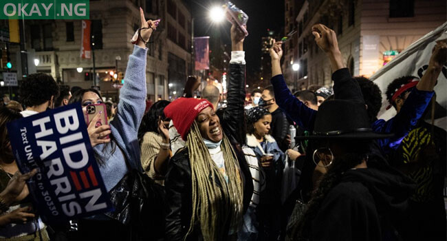 People dance in street after listening to President-elect Joe Biden address the nation after being declared the winner of the 2020 presidential election on November 07, 2020, in Philadelphia, Pennsylvania.