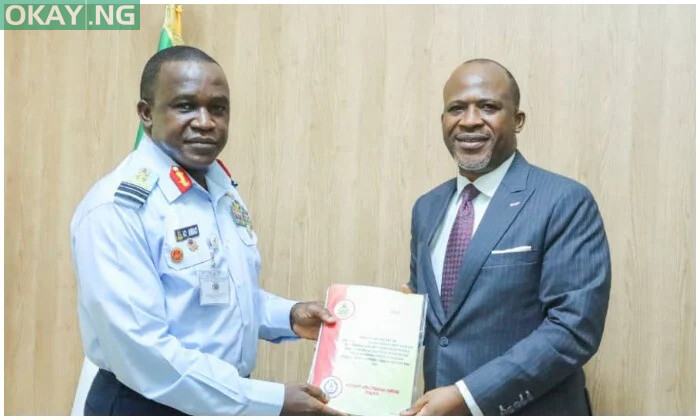 Chief Executive Officer of AIB, Engr Akin Olateru (right) hands over the interim report to Chief of Air Staff (CAS), Air Marshal Amao (left)