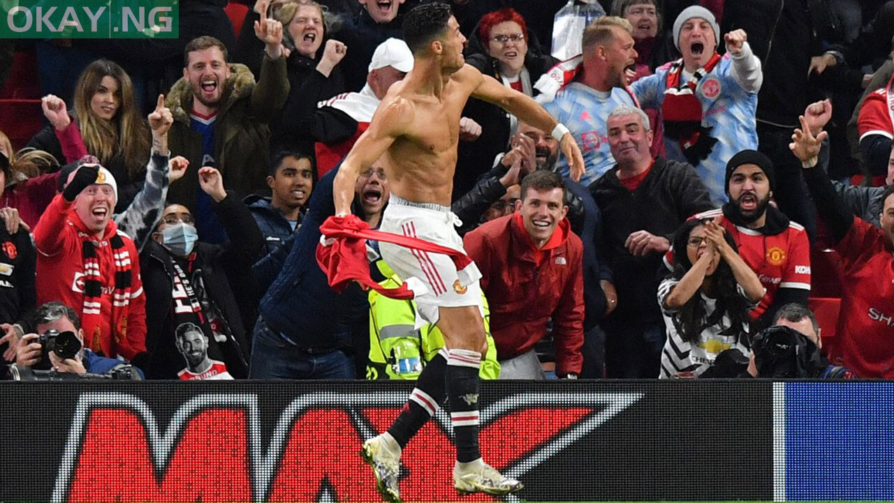 Manchester United's Portuguese striker Cristiano Ronaldo celebrates scoring his team's second goal during the UEFA Champions league group F football match between Manchester United and Villarreal at Old Trafford stadium in Manchester, north west England, on September 29, 2021. Manchester United won the match 2-0. Anthony Devlin / AFP