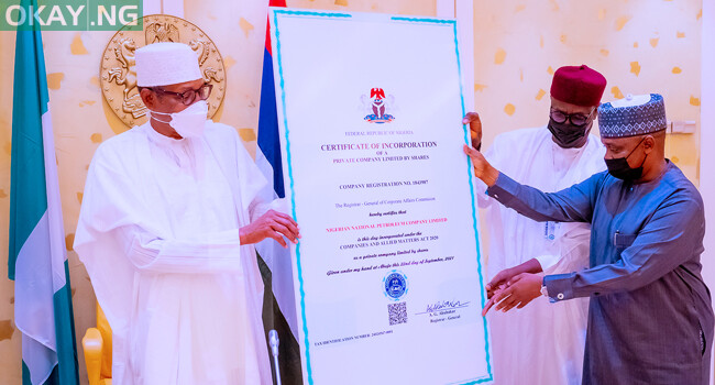 President Buhari receives the Certificate of Incorporation of the Nigeria National Petroleum Corporation on October 8.